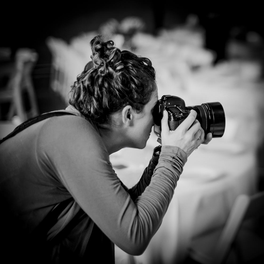 Julie shooting at a wedding.