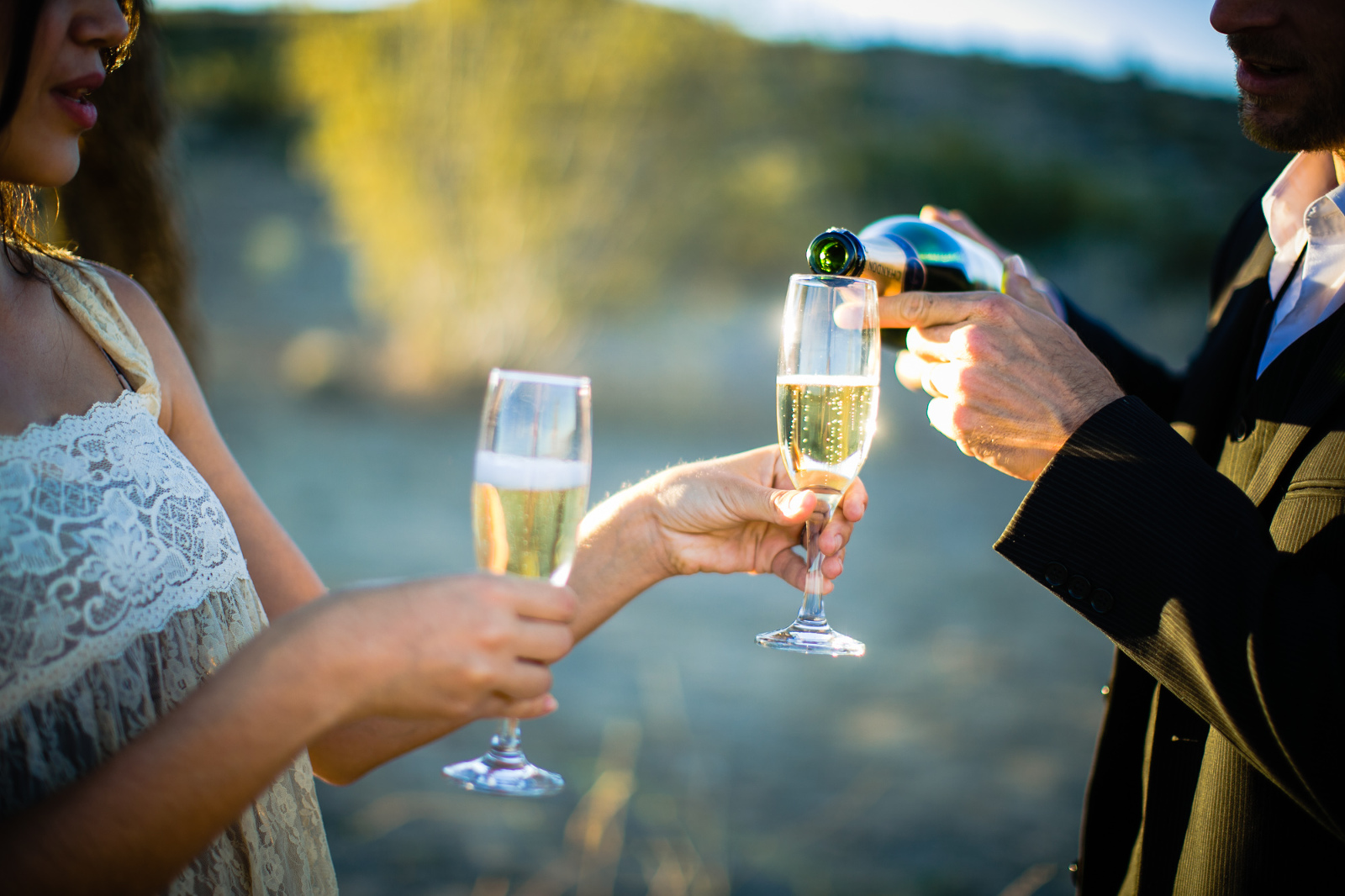Pouring a champagne toast.